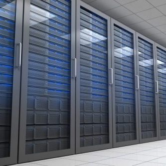 Hallway with row of tower servers in data centre